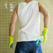 Man Cleaning Shower Tiles