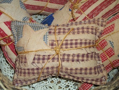 Primitive Applique Flag Pillows - Tied with twine.