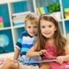 Two kids playing on an iPad