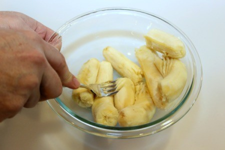 mashing banana with fork