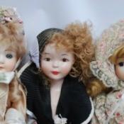 Photo of 3 vintage porcelain dolls.