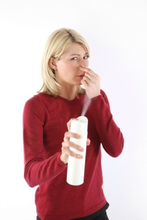 Woman Deodorizing in Her Home