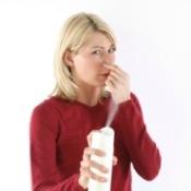 Woman Deodorizing in Her Home