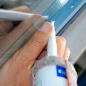 applying adhesive on a window