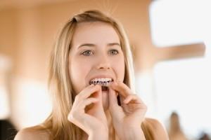 Girl Whitening Her Teeth