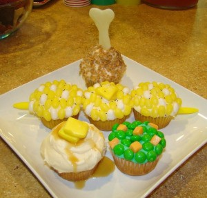 Cupcakes made to look like corn on the cob, mashed potatoes and peas.