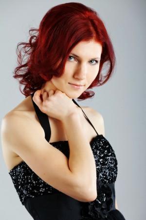 Woman with dyed auburn hair.
