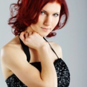 Woman with dyed auburn hair.