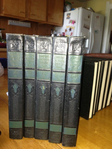 Five volumes of Compton's encyclopedia.