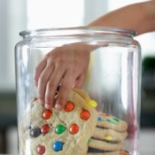Large cookies in a cookie jar.