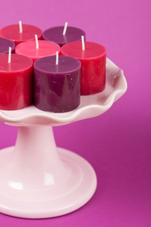 Candles on a cake stand.