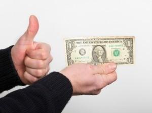 A man holding a dollar.