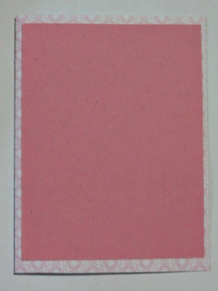 Pink paper glued to front.