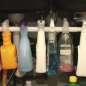 Closeup view of hanging spray bottles.