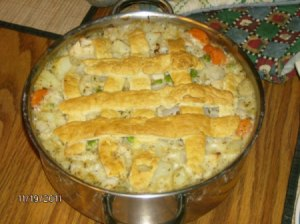 A homemade pot pie on a table.
