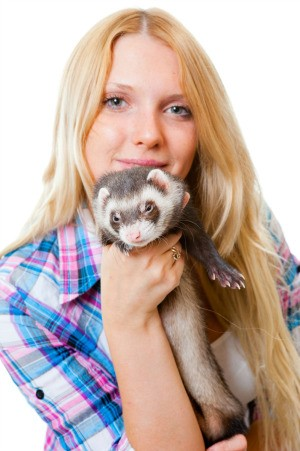 A girl with her pet ferret.