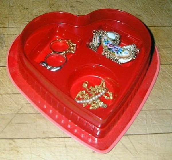 Plastic candy box insert for holding jewelry.