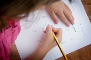 A girl working on a math.