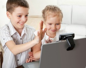 Two kids using video Skype.
