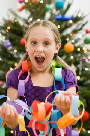 Girl with a paper chain garland.