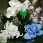 Blue and white spoon flowers, white fork flower in vase with artificial flowers.