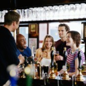 Young people drinking at a pub.