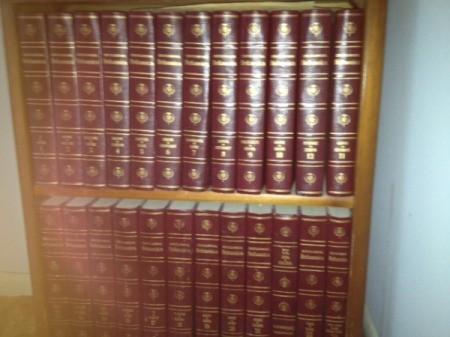Volumes on a bookshelf.