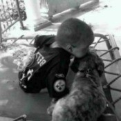 Tanner (Shih Tzu) - Young girl kissing the top of a dogs head.