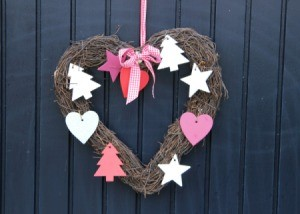 Heart shaped wreath on a door.