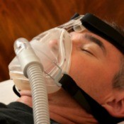 Man wearing a CPAP machine.