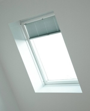 Skylight light with mini blinds.