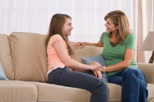 A mom talking to her teen daughter.