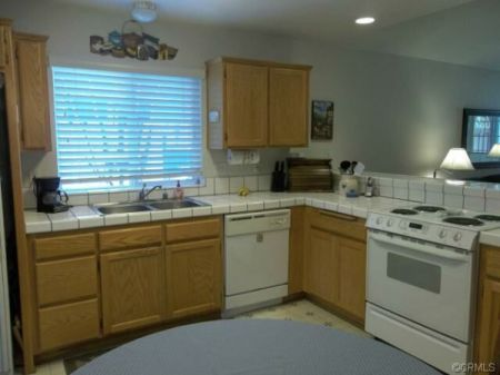 Kitchen with oak cabinets.