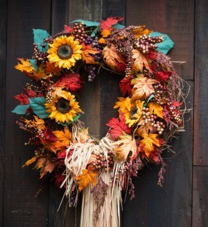 Autumn wreath made of flowers and leaves.