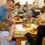 A large family eating breakfast.