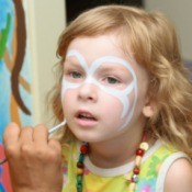 Girl having her face painted.