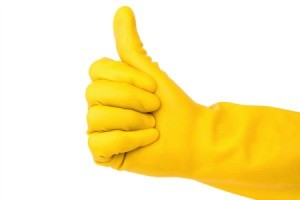 Rubber cleaning glove giving a thumbs up.