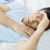 A man in restless sleep.