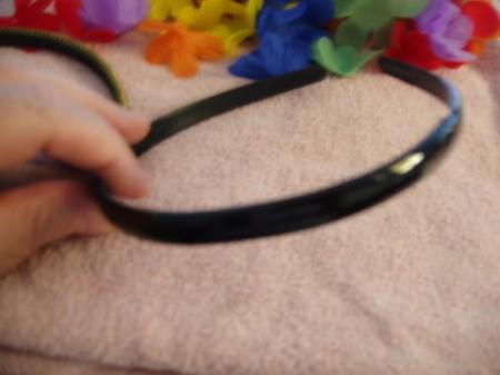 Black plastic headband.