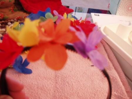 Gluing flowers onto headband.