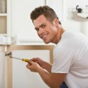 Handyman Fixing Cabinet
