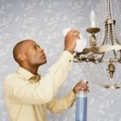 Man Polishing Metal Chandelier