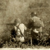 Two soldiers photographed fighting in WW II.