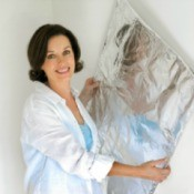 Woman Cooling Her Home With Additional Insulation
