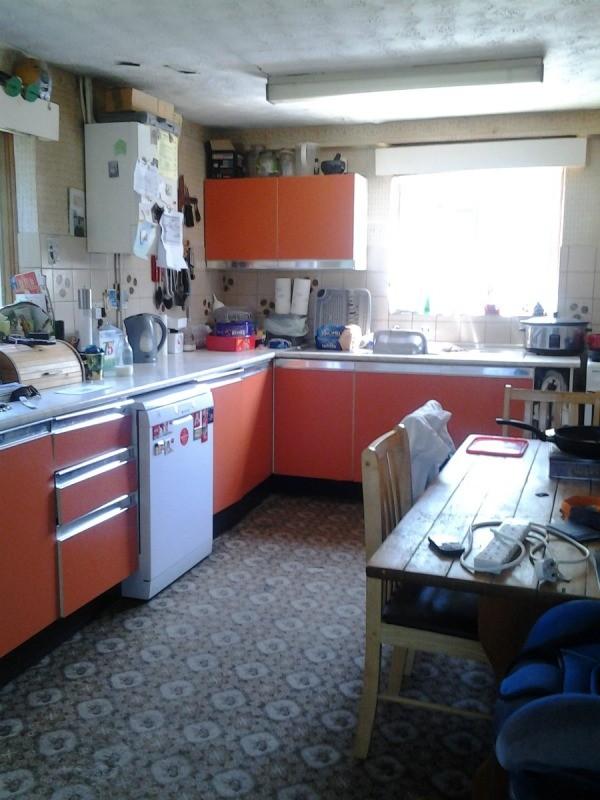Kitchen With Orange Cupboards