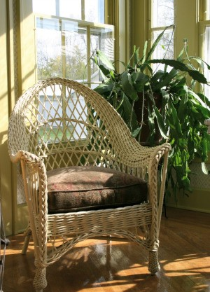 Wicker chair in a sunroom.