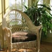Wicker chair in a sunroom.