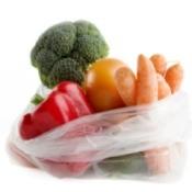 Plastic produce bag full of vegetables.