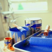 Paint can, tray, brushes and supplies.