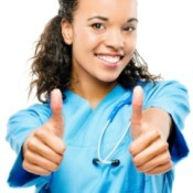 A happy nurse giving two thumbs up.